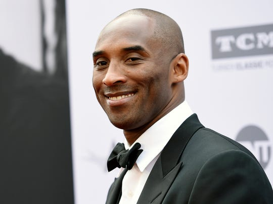 FILE - In this June 9, 2016 file photo, retired NBA basketball player Kobe Bryant poses at the 2016 AFI Life Achievement Award Gala Tribute to John Williams in Los Angeles. Bryant has received a one-of-a-kind retirement gift from rapper Snoop Dogg: a Los Angeles Lakers-themed convertible. He posted a picture on Twitter of him and Snoop standing by the purple and gold car Wednesday. (Photo by Chris Pizzello/Invision/AP, File)
