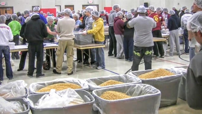 Feed My Starving Children's MobilePack No. 5 is Friday and Saturday at Angus Church of the Nazarene in Angus. The goal of the more than 500 volunteers is to help pack 108,863 meals for starving children in that short time span.