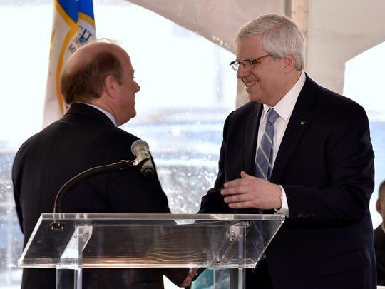 Detroit mayor Mike Duggan shakes his hands