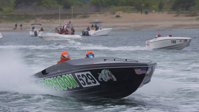 The boats for the first races head out of the inlet for the 2016 Offshore Grand Prix in Point Pleasant Beach on May 22, 2016