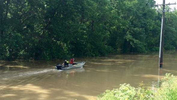 Officers search for a body reported floating in Delphi Thursday morning.