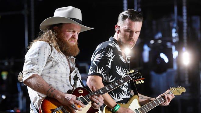 The Brothers Osborne perform at the 2018 CMA Music Fest Thursday, June 7, 2018, at Nissan Stadium in Nashville, Tenn.