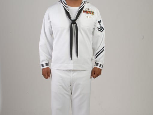 The new service dress whites are designed to be the mirror image of ...
