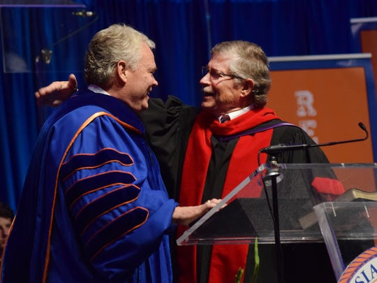 Don Wilton (right), pastor of the First Baptist Church in Spartanburg, S.C., presented a message and charge to Rick Brewer (left) in a ceremony where Brewer was inaugurated as the ninth president of Louisiana College in Pineville on Friday.