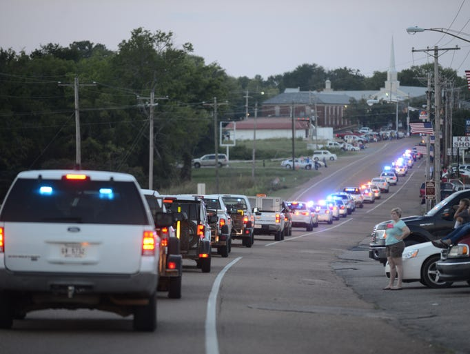 A Sea of Blue memorial procession was held for Savannah Police Department Patrolman Jamison Woody, 29, who died in a car crash Friday morning. The procession began at the Savannah Church of Christ and went throughout the town and over the Tennessee River.