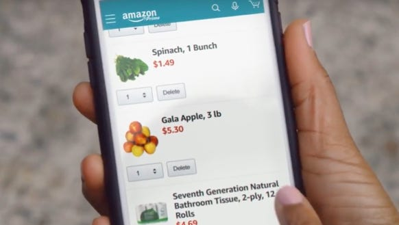An Amazon shopper chooses grocery items on her Amazon