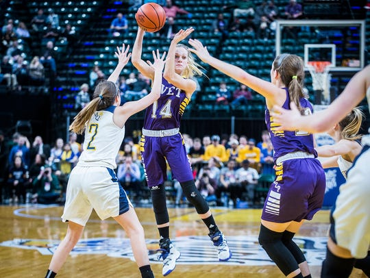 Vincennes Rivet's Grace Waggoner looks to pass against