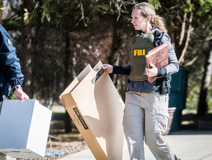Federal investigators removed boxes of documents, a