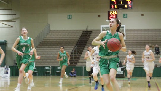 Irvington's Abby Conklin drives to the hoop during
