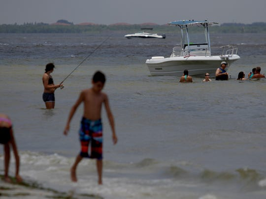 Boating, fishing, swimming and fishing are part of the appeal of area beaches, including the waters off Sanibel Island's Lighthouse Beach, pictured Friday.