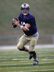 West Chester QB Joey Wright rolls out and looks for a receiver in a 2008 game against Lock Haven.