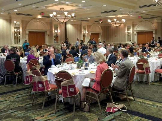 Attendees listen to Amy Ronshausen, deputy director of DrugFree America Foundation and Save Our Society from Drugs, speak Aug. 10, 2016, at Wake Up Naples at the Naples Hilton.