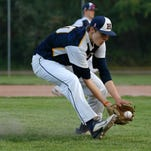 Haslett's Luke Sleeper scoops up the ball against St. Johns during their Diamond Classic game last week.