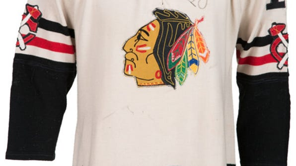 "This image provided by Heritage Auctions shows a Chicago Blackhawks' Bobby Hull jersey. Way back in 1961, Joe Serpico got a pair of game-worn jerseys from Chicago Blackhawks stars Bobby Hull and Glenn Hall for his 10th birthday. It was a gift from his beloved uncle Jerry ""The Barber"" Del Giudice, who served as the team barber for decades. Now Serpico is letting the Hull jersey go as part of an auction while remembering everything he loves about his family and his favorite hockey team. (Heritage Auctions via AP)"
