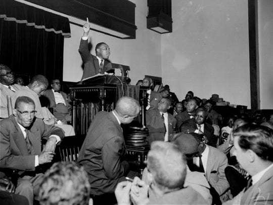 The Rev. Martin Luther King Jr. points skyward as he