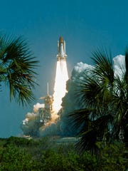 The STS-29 Discovery crew launched March 13, 1989,