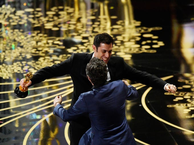 'Spotlight' screenwriter Josh Singer, with Oscar, congratulates