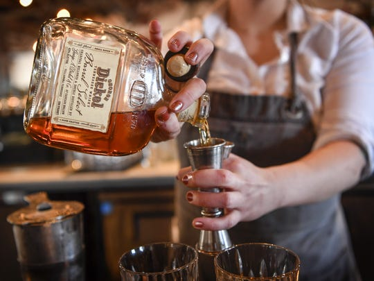 A bartender measures out George Dickel Tennessee Whisky Barrel Select at the Pinewood Social in Nashville, Tenn. The surge in consumer demand for whiskey has led to new distilleries cropping up around the state.