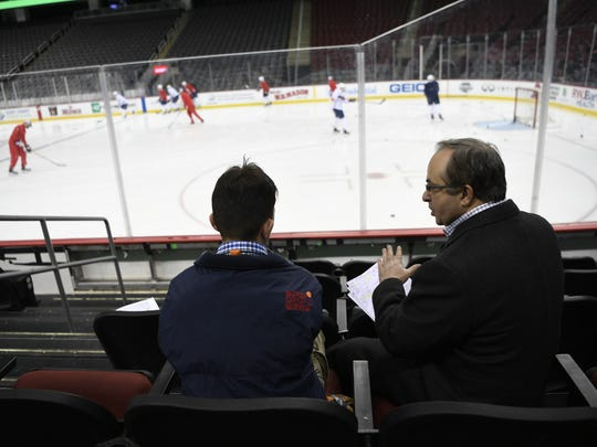 Jefferson High School senior Peter Fifoot, left, gets broadcasting pointers from NBC Sports Washington plaly-by-play announcer Joe Beninati during the Washington Capitals practice before facing the New Jersey Devils in Newark, New Jersey on Thursday, Jan. 18, 2018.