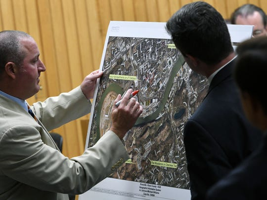 Knoxville Police Department investigator Tim Riddle marks locations on a map during his testimony in the trial of A.J. Johnson and Michael Williams on Thursday, July 26, 2018.