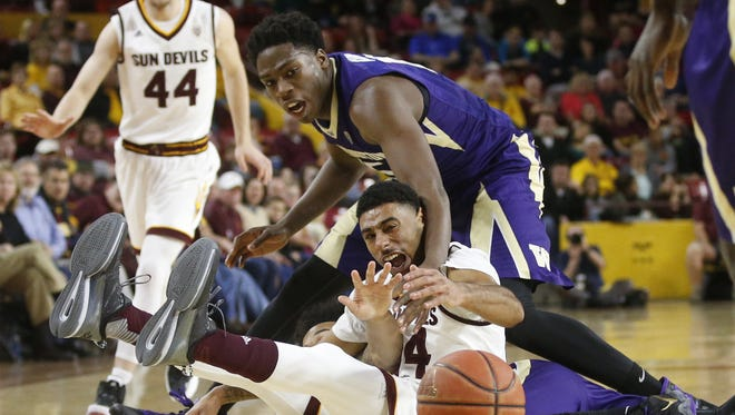 Washington forward Noah Dickerson attempts to steal the ball from Arizona State guard Andre Spight  during the game.