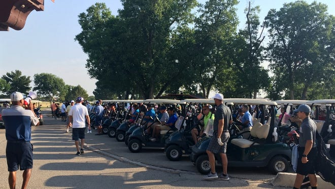 Dozens of golfers participated in Saturday's tournament at Riverside Country Club to benefit Brittany's Hope.