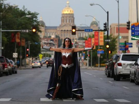 Wonderwoman, aka Laura Hraha-Morgan of Des Moines, is a member of the Iowa League of Heroes, which consists of fewer than 10 members, who all dress up in costume and visit children in area hospitals.