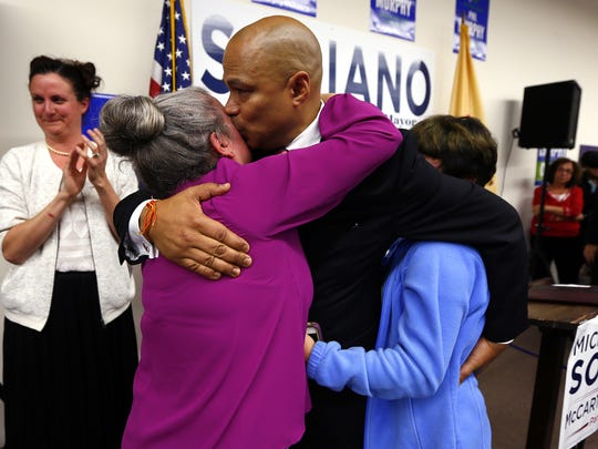 Democrat Michael Soriano kisses his wife Jennifer DeMaio and hugs daughter Eleanor Soriano after declaring victory in the Parsippany Mayoral race. November 7, 2017. Morris Plains, New Jersey