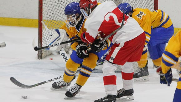North Rockland's Eric Dunn (2) is pressured by Mahopac's