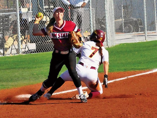 Jaime Guzman/For the Sun-News   New Mexico State third baseman Emma Adams completes the force out at thrid and tries to turn a double play against Arizona State at the NMSU Softball Complex.