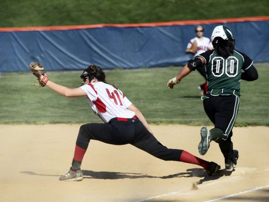 Cumberland Valley's Alexa Erney, left, stretches out to catch Abbie Doyka, of James Buchanan, out at first base on Thursday afternoon. Doyka had a pair of RBIs in the semfinals of the Mid Penn Conference Tournament, but the Eagles won, 11-5.