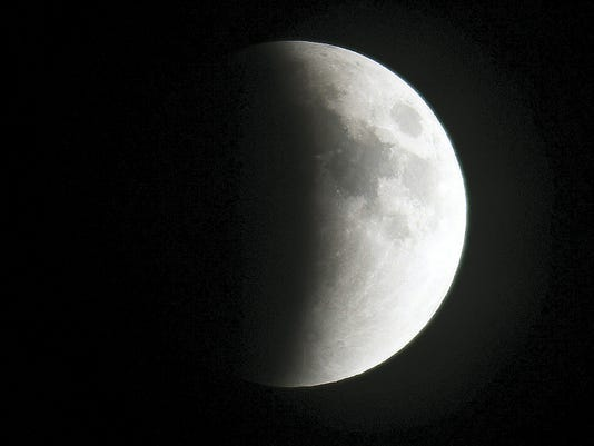 The moon is seen at the beginning of Sunday evening's total eclipse from Glen Rock. This eclipse is deemed a blood moon because the moon will become red once the Earth's shadow completely covers it.