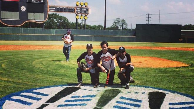 Jack White, center, celebrates his 40th birthday at Greer Stadium