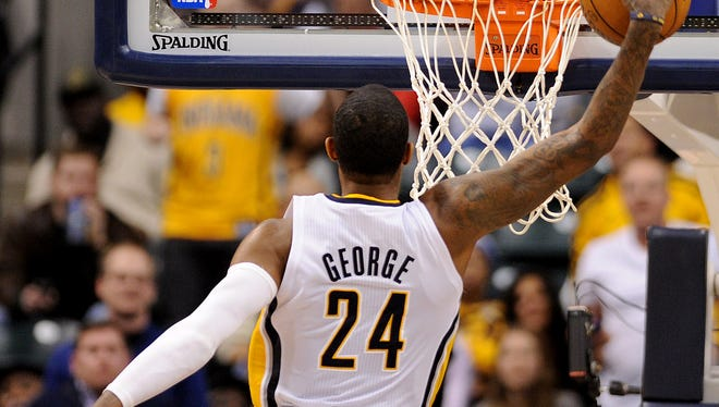 FILE - Indiana Pacers forward Paul George does a 360 dunk against the Los Angles Clippers inside Bankers Life Fieldhouse, Saturday, January 18, 2014, in Indianapolis.