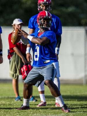 Dion Ray, now UL's No. 3 quarterback, throws during preseason camp last year.