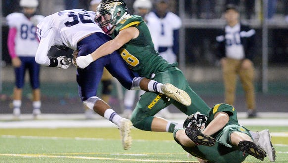 Reynolds players make a tackle during a Mountain Athletic