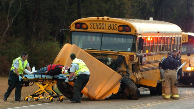 Paramedics respond to a wreck involving a school bus and an SUV on Hidden Hills Lane in January 2011.