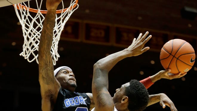 Iowa State guard Monte Morris, right, shoots over Georgia State guard Kevin Ware during the first half of an NCAA college basketball game, Monday, Nov. 17, 2014, in Ames, Iowa.