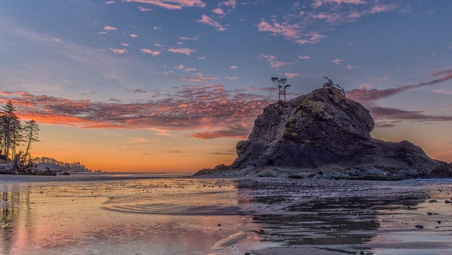 With over 922,000 acres, Olympic National Park in Washington is a land of beauty and variety. A day's exploration can take you from breathtaking mountain vistas with meadows of wildflowers to colorful ocean tide pools. This stunning photo was taken during sunrise at the park's Second Beach.
