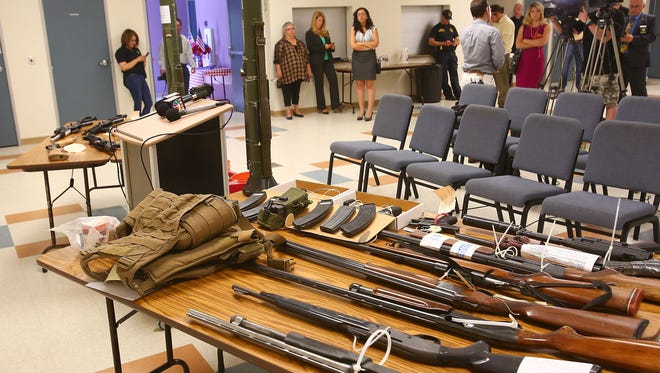 Weapons and ammunition seized by authorities during Operation Desert Impact were displayed during a news conference in Desert Hot Springs, June 16, 2016.
