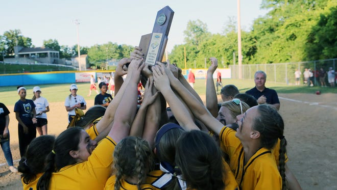 Notre Dame players pose with the 9th Region championship trophy after beating Dixie Heights 13-2.