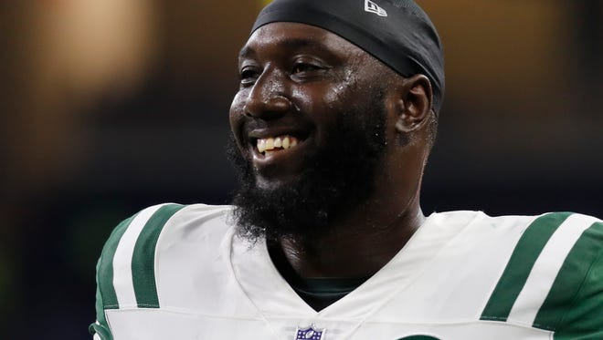 Former New York Jets defensive end Muhammad Wilkerson smiles during a preseason game in Detroit on Aug. 19, 2017.