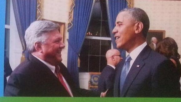 A recent campaign door-hanger of mayoral candidate Bill Freeman features an image with him and President Barack Obama.