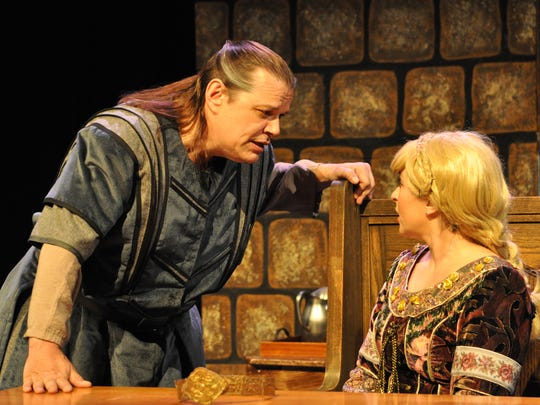 Bob Harper (left) and Tiffany Ayers rehearse Tuesday night for the Empty Space Players'  production of The Lion in Winter.