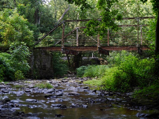 Hikers cross Kelly's Run for the first time next to this old bridge on the Kelly's Run Trail.