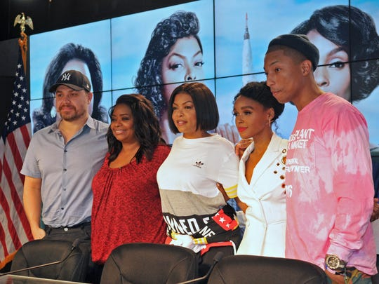 "Monday press conference for the upcoming film ""Hidden Figures"" was held at Kennedy Space Center. Left to right, Director and co-writer Theodore Melfi , actresses Octavia Spencer, Taraji P. Henson, and Janelle Monae, and Pharell Williams, one of the the producers, who also wrote some of the music. The film is based on the true story of a team of African-American women whose mathematical skills helped NASA in the early days of space missions."