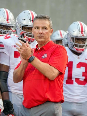 Ohio State coach Urban Meyer and his team prepares to take the field before their game against Indiana in 2017.