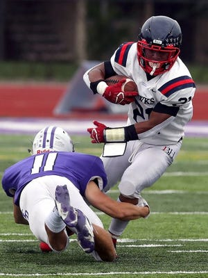 Nyal Johnson and Hartley play at St. Charles on Friday, Sept. 18, in the season opener for the host Cardinals.