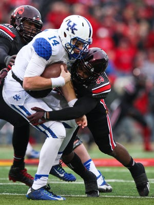 Kentucky's Patrick Towles gets sacked by Louisville's.  Nov. 29, 2014 By Matt Stone/The C-JKentucky's Patrick Towles gets sacked by Louisville's Keith Kelsey and B.J. Dubose in the second half Saturday. Nov. 29, 2014 By Matt Stone/The C-J