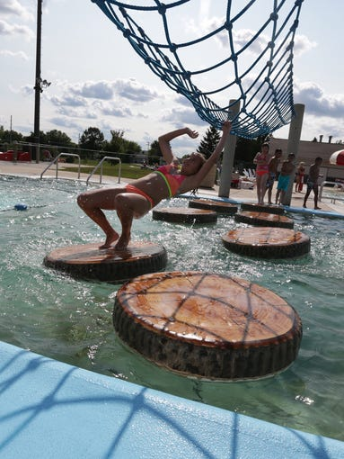 Youngsters were able to cool off as seasonal temperatures returned to the area, Thursday, July 17, 2014, at the Weston Aquatic Center.